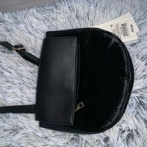 small black bag (sits on hip)